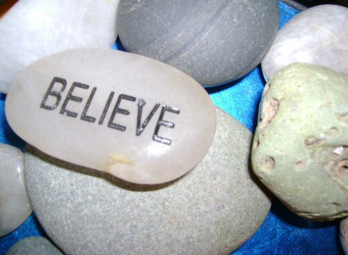 Believe written on a pebble
