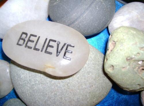 Believe written on a pebble