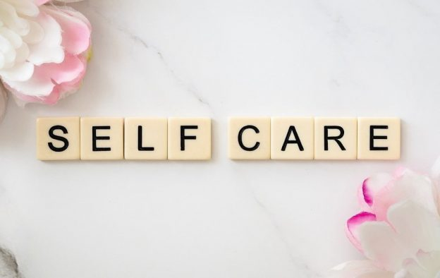 self care spelt in scrabble tiles